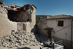 © London News Pictures. 25/08/2016. Amatrice, Italy. Earthquake damage is seen to a property in the town of Amatrice in central Italy where a 6.2-magnitude earthquake destroyed towns in the area. The death toll is currently at 247 with dozens of people still missing. Thousands of rescuers continue efforts to find survivors. Photo credit: Mario Sabatini/LNP
