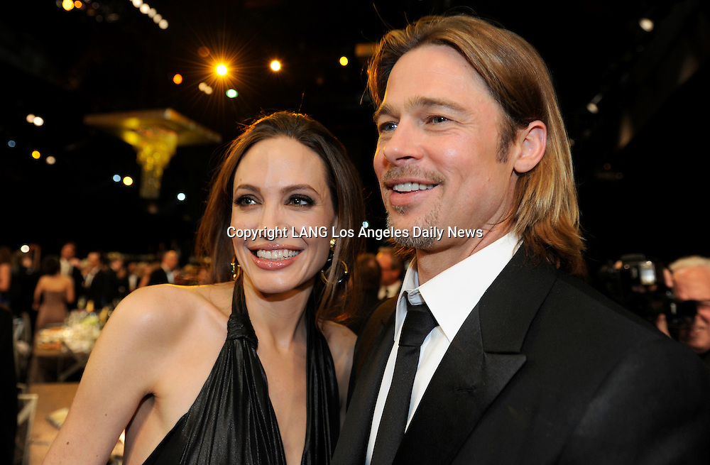 Angelina Jolie and Brad Pitt. The 18th Annual Screen Actors Guild Awards were held at the Shrine Exposition Center in Los Angeles, CA 1/29/2012(John McCoy/Staff Photographer)