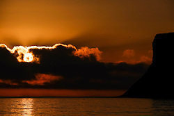 © Licensed to London News Pictures. <br /> 18/08/2016. <br /> Satburn-By-The-Sea, UK.  <br /> <br /> The sun shines from behind clouds on the horizon at dawn in Saltburn-By-The-Sea.<br /> <br /> Photo credit: Ian Forsyth/LNP
