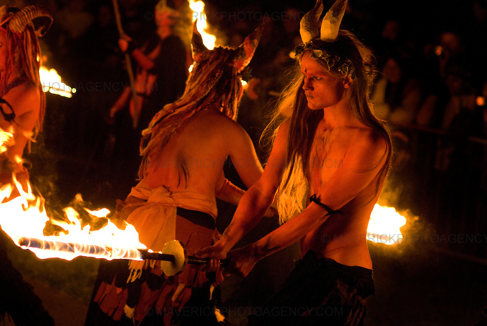 Members of the Beltane Society are seen celebrating the blossoming and fertility of spring on top of Calton Hill in Edinburgh, Scotland. The procession is a revival of the ancient Celtic festival of Beltane around three hundred voluntary performers celebrate the ending of winter in a spectacular procession of fire and colour.