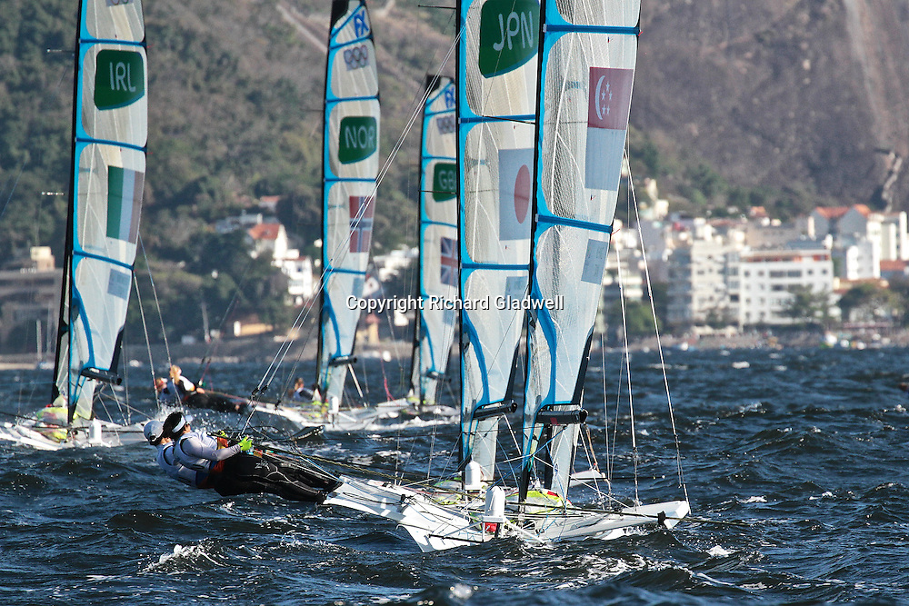 49er FX fleet split tacks and head for the Sugarloaf shift - Race 5.<br /> Rio 2016 Olympics, Rio de Janero, Brazil. Olympic Sailing Day 6, 13 August 2016.<br /> Photo credit: Richard Gladwell / www.photosport.nz