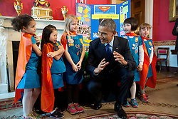 President Barack Obama views science exhibits during the 2015 White House Science Fair celebrating student winners of a broad range of science, technology, engineering, and math (STEM) competitions, in the Red Room, March 23, 2015. The President talks with Emily Bergenroth, Alicia Cutter, Karissa Cheng, Addy O'Neal, and Emery Dodson, all six-year-old Girl Scouts, from Tulsa, Oklahoma. They used Lego pieces and designed a battery-powered page turner to help people who are paralyzed or have arthritis. (Official White House Photo by Chuck Kennedy)<br /> <br /> This official White House photograph is being made available only for publication by news organizations and/or for personal use printing by the subject(s) of the photograph. The photograph may not be manipulated in any way and may not be used in commercial or political materials, advertisements, emails, products, promotions that in any way suggests approval or endorsement of the President, the First Family, or the White House.