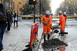 © Licensed to London News Pictures. 21/01/2020. London, UK. Workmen clearing the mud outside Southwark Tube station after flooding from burst pipe. Photo credit: Dinendra Haria/LNP
