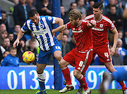 Brighton striker Tomer Hemed & Middlesbrough midfielder Adam Clayton battle for possession during the Sky Bet Championship match between Brighton and Hove Albion and Middlesbrough at the American Express Community Stadium, Brighton and Hove, England on 19 December 2015. Photo by Bennett Dean.