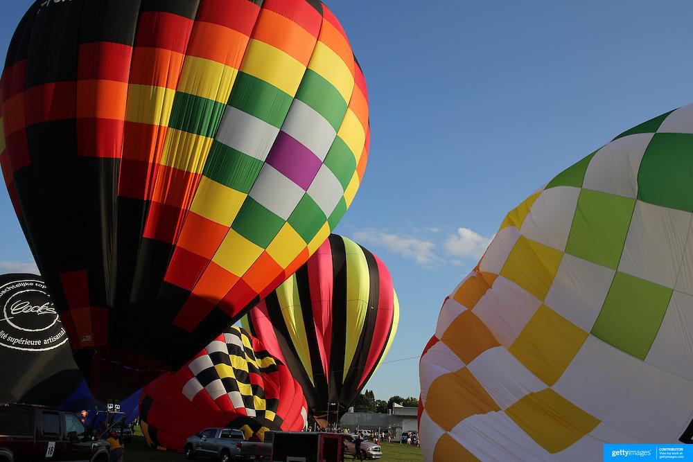 Pilots prepare to launch around rural Michigan near Battle Creek during the World Hot Air Ballooning Championships. Battle Creek, Michigan, USA. 21st August 2012. Photo Tim Clayton