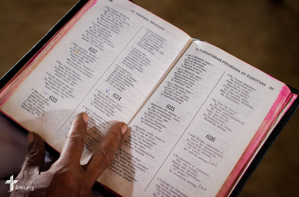 A parishioner sings from a hymnal at the beginning of worship at Ivato Lutheran Church in the capital city of Antananarivo in Madagascar, on Sunday, Feb. 9, 2014. LCMS Communications/Erik M. Lunsford