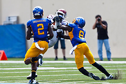 September 24, 2011; San Jose, CA, USA;  New Mexico State Aggies wide receiver Taveon Rogers (center) catches a pass in front of San Jose State Spartans cornerback Brandon Driver (8) and safety Duke Ihenacho (2) during the second quarter at Spartan Stadium.