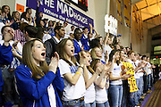 """The Madison student section, including (l to r) Sarah Strahan, Katie Sorrell, and Jessica Schmitt cheer on the Mountaineers.  Madison students took up residence in JMU's """"Madhouse"""" student section.  Date:  March/6/10, Group A, Division 1, State Quarter Finals, Madison Mountaineers vs Surry Cougars.  Madison defeats Surry 72-58 to advance to the Group A, D1, Semi Finals at the Siegal Center at VCU in Richmond."""