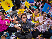 "01 AUGUST 2013 - BANGKOK, THAILAND: Thais wave pictures of Bhumibol Adulyadej, the King of Thailand, and the yellow flag of the monarchy while they chant ""Long Live the King"" at Siriraj Hospital before the King, 85, was discharged from Bangkok's Siriraj Hospital, Thursday where he has lived since September 2009. He traveled to his residence in the seaside town of Hua Hin, about two hours drive south of Bangkok, with his wife, 80-year-old Queen Sirikit, who has also been treated in the hospital for a year.       PHOTO BY JACK KURTZ"