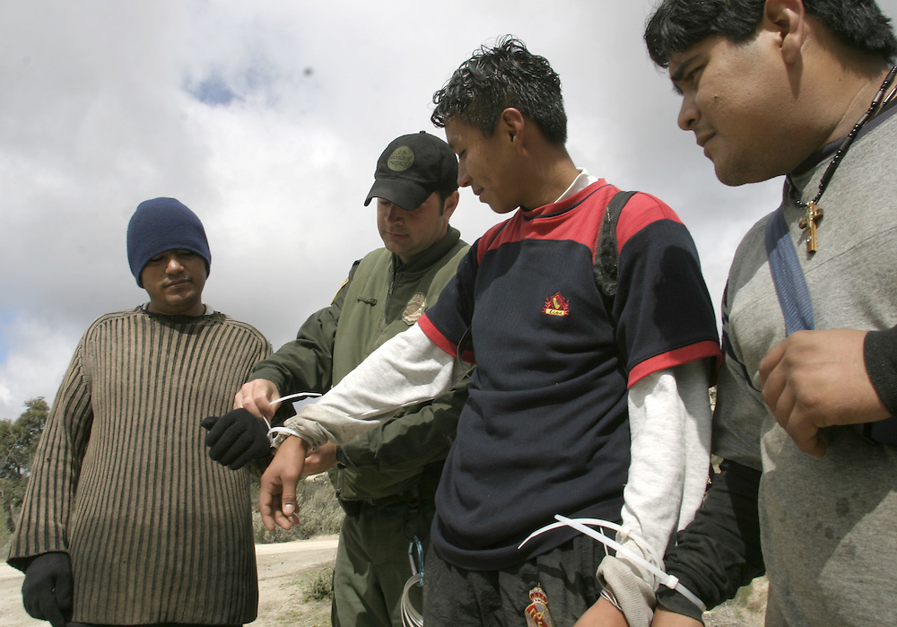 A U.S.A border patrol arrest undocumented immigrants that been watched by the minuteman members at the 21April 2006 next to Boulevard about 65 miles (104.6 km) east of downtown San Diego.......In the photo n the photo:..Raoll 28(with black hat and gloves) marriage +3 kids try to get to the USA to work in L.A....Yshmael 21 (T-Shirt with red sleeves)..Oskar (gray Shirt )..