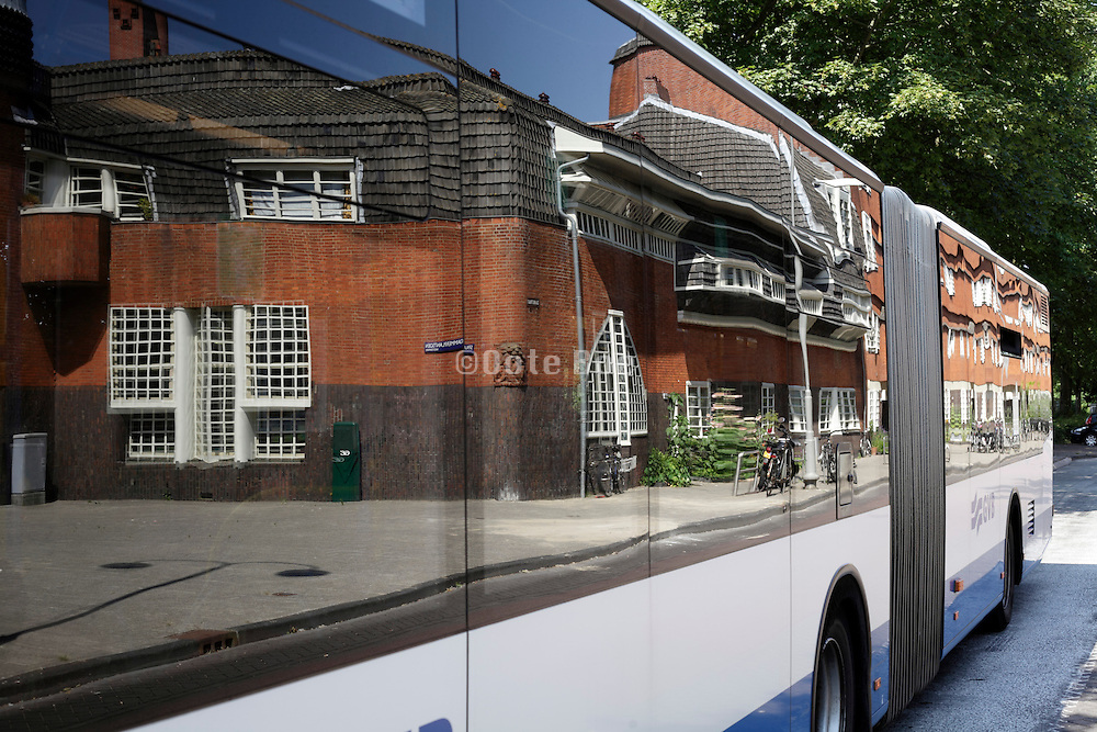 Het Schip Amsterdam school architecture by Michel de Klerk reflecting in a bus window