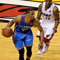 Jun 21, 2012; Miami, FL, USA; Oklahoma City Thunder point guard Russell Westbrook (0) drives past Miami Heat point guard Mario Chalmers (15) during the third quarter in game five in the 2012 NBA Finals at the American Airlines Arena. Mandatory Credit: Derick E. Hingle-US PRESSWIRE