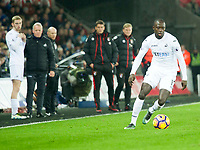 Football - 2016 / 2017 Premier League - Swansea City vs. AFC Bournemouth<br /> <br /> Mark Birighitti of Swansea attacks watched by Swansea City caretaker manager Alan Curtis  on the touchline---, at the Liberty Stadium.<br /> <br /> COLORSPORT/WINSTON BYNORTH