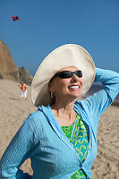 Woman Enjoying Sunlight on Her Face at Beach