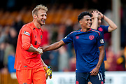 Zdenek Zlamal (#1) of Heart of Midlothian and Demetri Mitchell (#11)  of Heart of Midlothian celebrate after Hearts win the Ladbrokes Scottish Premiership match between Motherwell and Heart of Midlothian at Fir Park, Motherwell, Scotland on 15 September 2018.