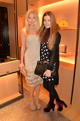 Left to right, MARISSA MONTGOMERY and KATIE READMAN at the opening party for Moynat's new Maison de Vente in Mayfair at 112 Mount Street, London W1 on 12th March 2014.