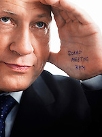 Bored Businessman with note on his palm