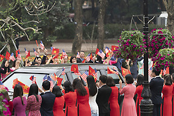 February 27, 2019 - Hanoi, Vietnam - The motorcade of U.S President DONALD TRUMP is greeted by citizens waving American and Vietnamese flags on arrival to the Office of Government Hall February 27, 2019 in Hanoi, Vietnam. (Credit Image: © Shealah Craighead/The White House via ZUMA Wire)
