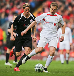 Lucas Lieva is chased by Fernando Torres - Photo mandatory by-line: Dougie Allward/JMP - Mobile: 07966 386802 - 29/03/2015 - SPORT - Football - Liverpool - Anfield Stadium - Gerrard's Squad v Carragher's Squad - Liverpool FC All stars Game