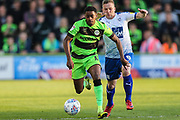 Forest Green Rovers Reece Brown(10) runs forward under pressure from Tranmere Rovers Jay Harris(8) during the EFL Sky Bet League 2 second leg Play Off match between Forest Green Rovers and Tranmere Rovers at the New Lawn, Forest Green, United Kingdom on 13 May 2019.