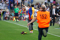 Real Madrid´s supporter jumps into the field during 2014 Supercopa de España `Spain Supercup´ second leg match at Vicente Calderon stadium. August 22, 2014. (ALTERPHOTOS/Victor Blanco)