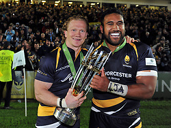Tom Biggs and Cooper Vuna of Worcester Warriors celebrate with the trophy - Photo mandatory by-line: Patrick Khachfe/JMP - Mobile: 07966 386802 27/05/2015 - SPORT - RUGBY UNION - Worcester - Sixways Stadium - Worcester Warriors v Bristol Rugby - Greene King IPA Championship Play-off Final (Second leg)