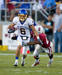 September 19, 2009; Stanford, CA, USA;  San Jose State Spartans wide receiver Kevin Jurovich (6) is tackled by Stanford Cardinal safety Delano Howell (26) in the first quarter of the game at Stanford Stadium.