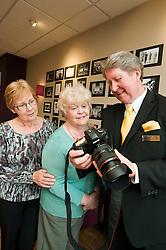 Left to right .Dorothy Wright and Beryl Wood with Royal Photographer Ian Pelham-Turner in the Debenhams restaurant Harrogate on Thursday evening..7 June 2012.Image © Paul David Drabble