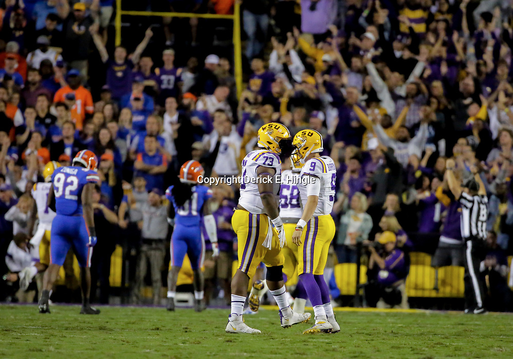 Oct 12, 2019; Baton Rouge, LA, USA; LSU Tigers quarterback Joe Burrow (9) and offensive lineman Adrian Magee (73) celebrate after a touchdown against the Florida Gators during the first half at Tiger Stadium. Mandatory Credit: Derick E. Hingle-USA TODAY Sports