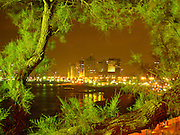 Israel,Tel Aviv beach front as seen from south, from Jaffa, at night view framed by trees