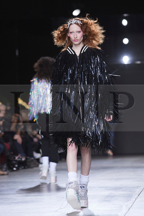 © Licensed to London News Pictures. 17 February 2014, London, England, UK. A model walks the runway at the Ashish show during London Fashion Week AW14 at the Topshop Show Space/Tate Modern. Photo credit: Bettina Strenske/LNP