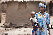 A woman holds her child in the village of Banankoro, Mali on Saturday August 28, 2010..