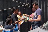 Roma 13 Giugno 2015<br /> I migranti nel centro di accoglienza  per migranti 'Baobab' vicino alla stazione ferroviaria Tiburtina di Roma. Centinaia di  migranti provenienti da Etiopia, Somalia ed Eritrea, tutti  arrivati negli ultimi mesi dalla Libia con i barconi e portati in Italia dopo essere stati salvati in mare. Distribuzione degli aiuti alimentari ai migranti.<br /> Rome June 13, 2015<br /> Migrants in the reception center for migrants 'Baobab' close to the Tiburtina train station in Rome. Hundreds of migrants mainly from Ethiopia, Somalia and Eritrea, all arrived in recent months from Libya with the barges and taken to Italy after being rescued at sea. Distribution of food aid to migrants.