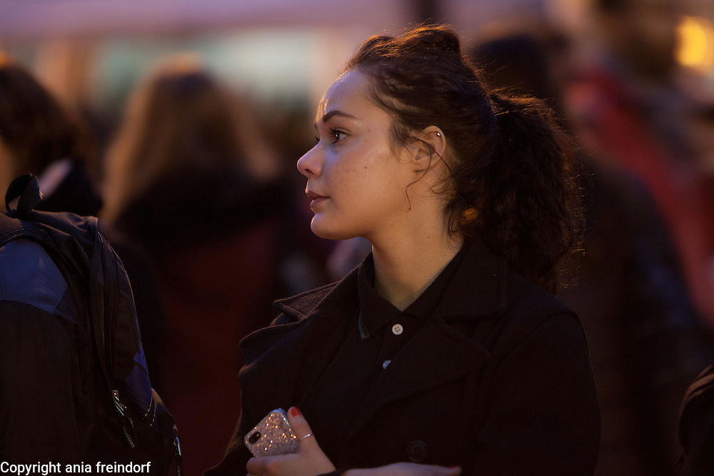 "Paris Terrorist Attacks, people Mourning in front of Bar ""Le Carillon"" and Restaurant ""Le Petit Cambodge"", where 15 people died from Kalashnikov shooting on 13/11/15. Young Woman crying"