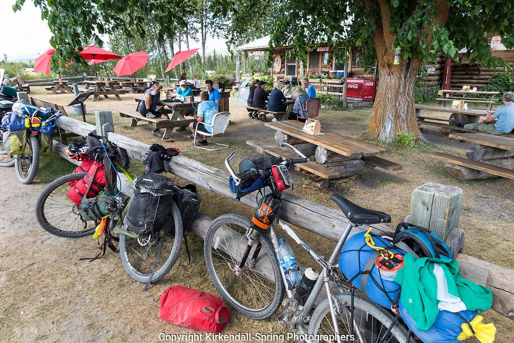 BC00645-00...MONTANA - Crew ridding the Great Divide Mountain Bike Route take a break in Polbridge.