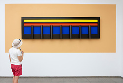 Woman looking at painting  Napoli 1987 by Gerhard Merz at Hamburger Bahnhof art museum in Berlin, Germany. .Editorial Use Only.