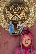 Mongolia. little girl in front of  Erdene Zuu temple main gate  Hakhorin - Mongolia  Children fashion ,  Deux par Deux collection / petite fille devant la porte du temple de Erdene Zuu  Karakorum - Mongolie Mode enfant  / 17