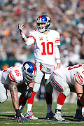 New York Giants quarterback Eli Manning (10) looks over the defense during the NFL week 8 football game against the Philadelphia Eagles on Sunday, Oct. 27, 2013, at Lincoln Financial Field in Philadelphia, Pennsylvania. The Giants won the game 15-7. (Joe Robbins)