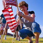 08/29/11 Bear DE: Volunteer Cindy O'Donnell install one of 6,194 flags that represents every soldier that died in the war on terror including three soldier that died in Afghanistan on Aug. 29, 2011. ..The flags will be seen on the front lawn of Glasgow Reformed Presbyterian Church...The News Journal/SAQUAN STIMPSON