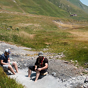 Giorgi Shavishvili (left) and Vakhtangi Tsutskiridze soaking their feet in a sulphur spring on the edge of the village of Abano in the Truso Valley, close to the frontier of the occupied territory of South Ossetia in the Mtskheta-Mtianeti region of Georgia. Shavishvili is a friend of the nuns in the abbey and Tsutskiridze is the brother of one of them, and the two had spent the morning doing construction work as volunteers. For most of the year the valley is home only to a lone homesteader, a monk, and four nuns and a priest who live in the abbey.