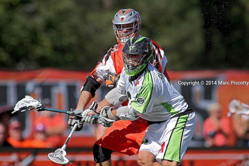 SHOT 8/16/14 3:13:08 PM - The Denver Outlaws Anthony Kelly #47 and the New York Lizards Rob Pannell #3 get tangled up during their MLL Semifinals matchup at Peter Barton Lacrosse Stadium on the University of Denver campus in Denver, Co. Saturday. The Denver Outlaws won the game 14-13 to advance. (Photo by Marc Piscotty / © 2014)