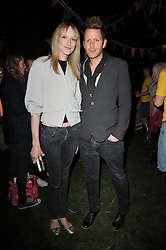 JADE PARFITT and IAN LAMARRA at a party to celebrate the global launch of the Iconic Brazilian lifestyle brand Havaianas Wellies range held at Selfridges, Oxford Street, London on 14th April 2011.