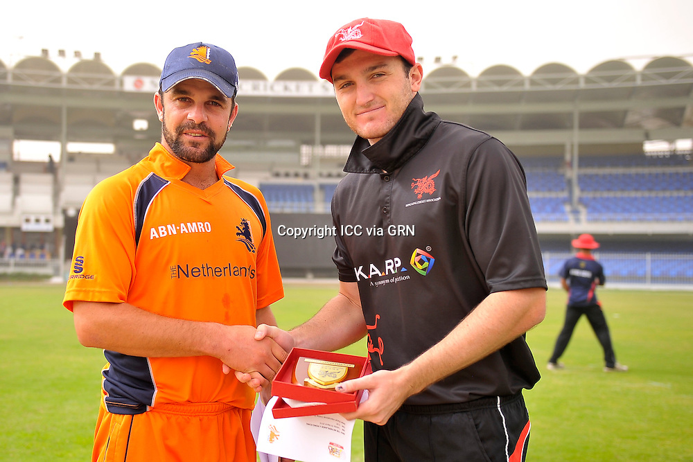 The Dutch Captain Peter Borren (L) and Hk's Captain James John Atkinson before the toss at the ICC World Twenty20 Qualifier UAE 2012. Pix ICC/Thusith Wijedoru