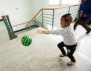 WUHAN, CHINA - NOVEMBER 16: (CHINA OUT) <br /> <br /> 3D-Printed Hand Completed<br /> <br /> A child wears 3D-printed hand while playing a ball at Wuhan Third Hospital on November 16, 2015 in Wuhan, Hubei Province of China. A child, a farmer Liu Tao\'s son, fell into a fiery pit where straws was burning when he was only three years old. Left ear and left hand got injured heavily that the left hand had to be cut. While a phone in May this year from Wuhan Third Hospital gave them hope that the lost left hand could be replaced by 3D-printed hand and luckily it made success on the child finally.<br /> ©Exclusivepix Media