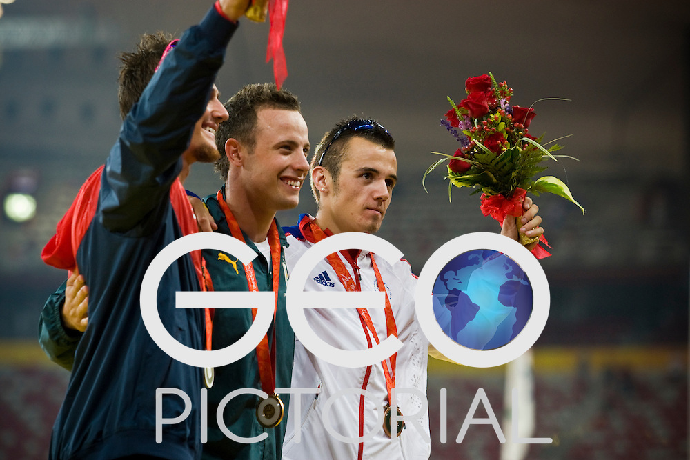 "L-R: Jim-Bob Bizzell of the USA (silver), Oscar Pistorius of South Africa (gold), Ian Jones of Great Britain (bronze) pose for a group shot with their medals for the men's T44 400m final on Day 8 of the 2008 Beijing 2008 Paralympic Games at the National ""Bird's Nest"" Stadium in Beijing, China on the 16th September 2008;"