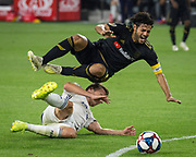 LAFC forward Carlos Vela (10) gets tripped up by FC Dallas defender Bressan (4) during a MLS soccer match against the FC Dallas in Los Angeles, Thursday, May 16, 2019. LAFC defeated FC Dallas 2-0.  (Ed Ruvalcaba/Image of Sport)