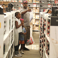 Patrick Berry, of Tupelo, shops with his daughter Saniya, 9, and son, King, 4, during the no tax sales event at JCPenney's at The Mall at Barnes Crossing Friday afternoon.