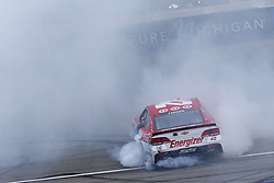August 13, 2017 - Brooklyn, Michigan, United States of America - August 13, 2017 - Brooklyn, Michigan, USA: Kyle Larson (42) does a burnout after winning the Pure Michigan 400 at Michigan International Speedway in Brooklyn, Michigan. (Credit Image: © Justin R. Noe Asp Inc/ASP via ZUMA Wire)