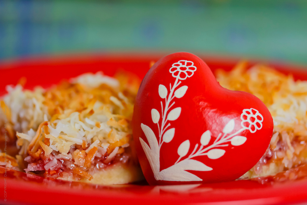 decorated red heart displayed with raspberry coconut slice