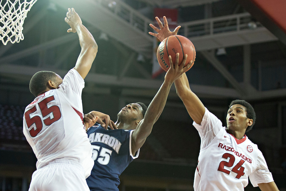 FAYETTEVILLE, AR - NOVEMBER 18:  Moses Kingsley #33 and Jimmy Whitt #24 of the Arkansas Razorbacks defends and blocks the shot of Antino Jackson #55 of the Akron Zips at Bud Walton Arena on November 18, 2015 in Fayetteville, Arkansas.  (Photo by Wesley Hitt/Getty Images) *** Local Caption *** Moses Kingsley; Jimmy Whitt; Antino Jackson